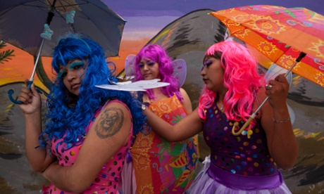 Female inmates wearing butterfly costumes attend an event that celebrates the first days of Spring at a prison for women in Lima, Peru. The event is part of a program that aims to help prisoners reduce stress and build self confidence.