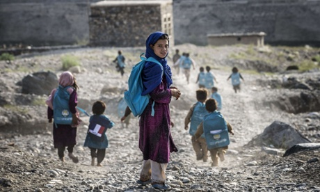 Afghan children run to school in a village on the road to Naghlu near the French army base. France is the fifth largest contributor to NATO's International Security Assistance Force (ISAF), which is due to pull out the vast majority of its 130,000 troops by the end of 2014