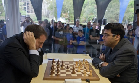 Chess players Viswanathan Anand of India, right, and Francisco Vallejo of Spain compete during the Chess Grand Slam Final Masters inside a case of glass at the Ibirapuera Park in Sao Paulo, Brazil.