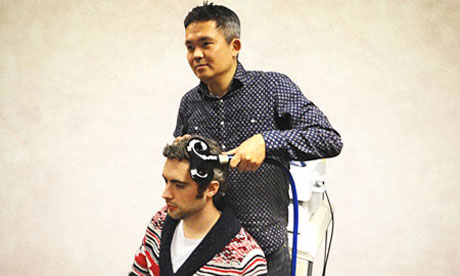 Co-author Ryota Kanai administering transcranial magnetic stimulation (TMS) to a participant's brain