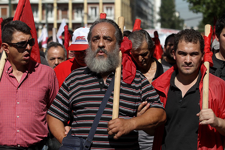 Greece protests: Workers shout slogans during a general strike protest