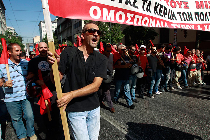 Greece protests: Supporters of the Greek Communist party march
