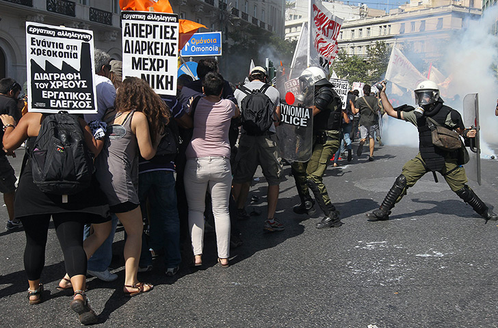 Greece protests update: Protesters  clash with riot police during a  a general strike
