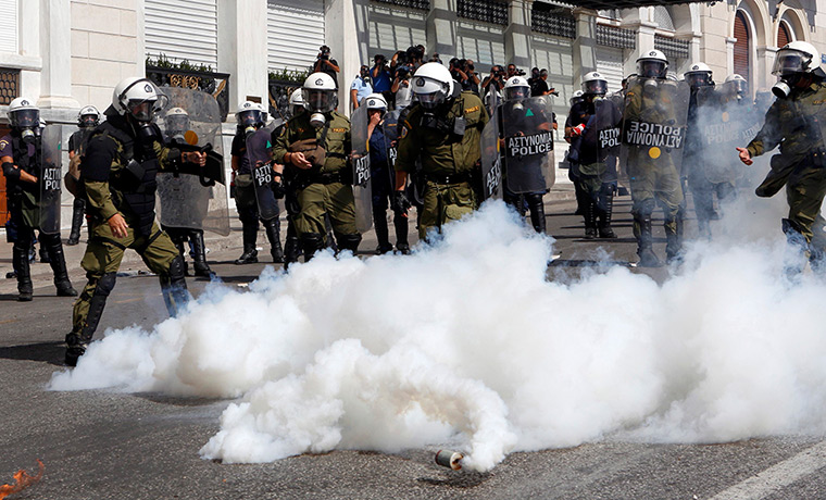 Greece protests update: Teargas canisters explode beside riot police