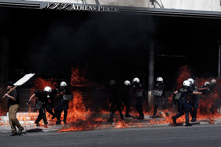 Greece protests update: Riot police are seen in flames after being hit by molotov cocktails