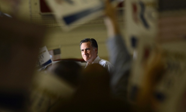 Peering through the crowd, Mitt Romney delivers a speech during a campaign rally at Westerville South High School in Westerville, Ohio, USA.