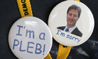 Badges mocking Conservative MP Andrew Mitchell and celebrating party leader Nick Clegg's apology.