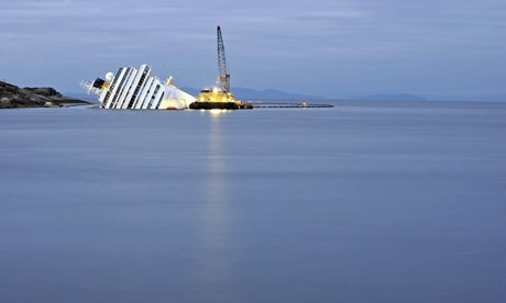 The Italian cruise ship Costa Concordia lies aground in front of Giglio island