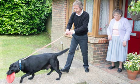 Janet Penton, her dog Taurus and Rotherfield St Martin volunteer dogwalker Jeremy Smith