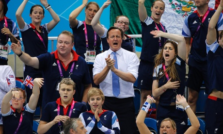 Prime Minister David Cameron cheers on Eleanor Simmonds during her win in the women's 200m IM SM6 final.