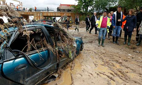 Spain's employment minister, Fatima Banez, inspects flood damage in Villanueva del Rosario after torrential rain hit Malaga in south-east Spain