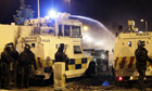 Northern Ireland police use a water cannon on rioters