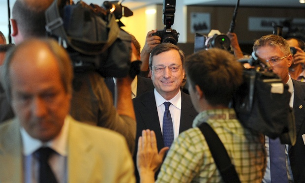 European Central Bank (ECB) chief Mario Draghi leaves the meeting with members of Economic and monetary Affairs Committee at the EU headquarters in Brussels on September 3, 2012.