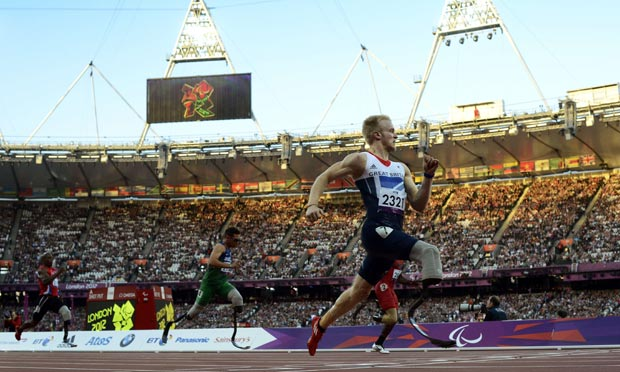 Britain's Jonnie Peacock winning his 100m T44 heat on 5 September 2012.
