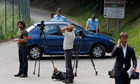 Journalists gather near the site of the killings in the French Alps