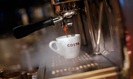 Costa cup on a coffee machine