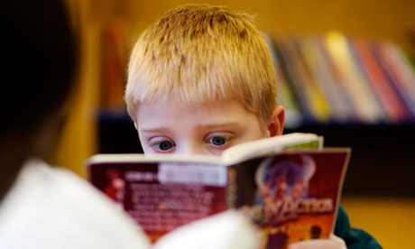 Child reads in library