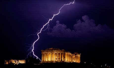 A flash of lightning illuminates the sky over the Parthenon temple on the Acropolis, Athens.