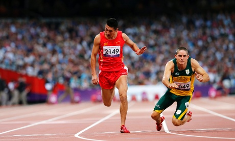 South Africa's Fanie van der Merwe dives over the line to win the men's 100m T37 final.