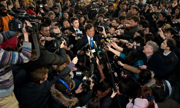Former New Mexico governor Bill Richardson finds himself at the centre of the media circus with Google chairman Eric Schmidt, centre left, on their arrival at Beijing airport from North Korea.  Richardson and Schmidt have been on a mission to North Korea calling for greater internet freedom for the welfare of its people.