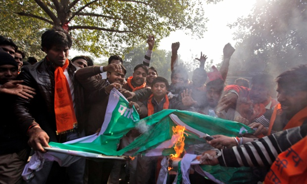 Activists of the right wing Hindu nationalist Bajrang Dal set fire to a Pakistani flag during a protest in New Delhi. India has formally complained about an attack on an Indian army patrol in the disputed Himalayan region of Kashmir that killed two soldiers. Indian authorities claim Pakistani troops crossed the cease-fire line on Tuesday and attacked the soldiers patrolling in the Mendhar region.