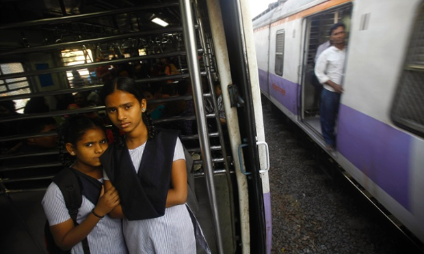 Indian schoolgirls travel in the women's compartment of a train in Mumbai early this morning. Five men charged with the gang-rape of a 23-year-old woman who subsequently died of her injuries are appearing in court again today. The case has sparked demonstrations across India by protestors who say India's legal system doesn't do enough to prevent attacks on women.