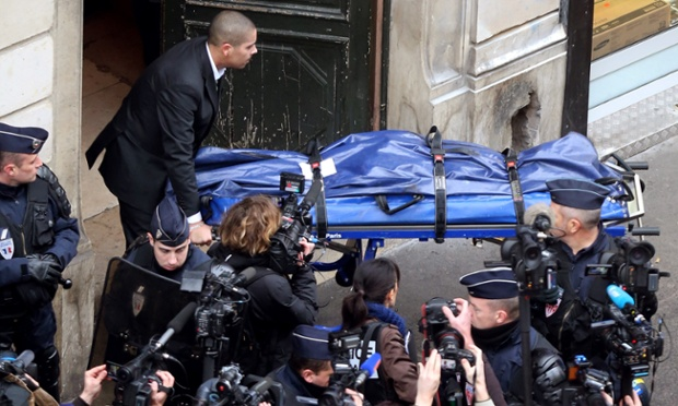 The body of one of three Kurdish women who were found killed by gunshot is removed from the Kurdish Institute in Paris. Sakine Cansiz, a PKK co-founder was among the three women found dead in the office building with bullet wounds to the neck and chest. Angelique Chrisafis reports from Paris. Photograph: Thomas Samson/AFP/Getty Images