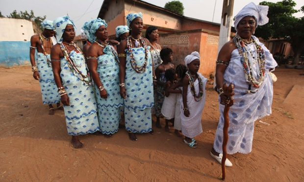 Voodoo priestess Djbassi Manonwomin leads fellow worshippers of a mermaid deity to a Voodoo Festival in Ouidah, Benin. Voodoo is an official religion in this nation of 9 million people; and the festival honored the slaves taken from surrounding countries and sent into America and the Caribbean.