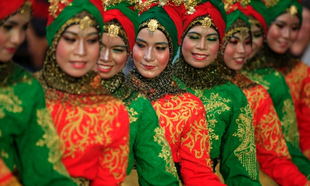 Acehnese dancers perform a Ratep Meusekat Dance in Banda Aceh, Indonesia.