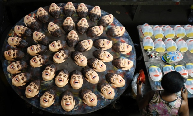Making faces: carnival masks bearing the likeness of Brazilian soccer player Neymar, are pictured on a factory assembly line in Sao Goncalo, near Rio de Janeiro. Every year, masks of different characters such as soccer players and politicians are created for the city's carnival.