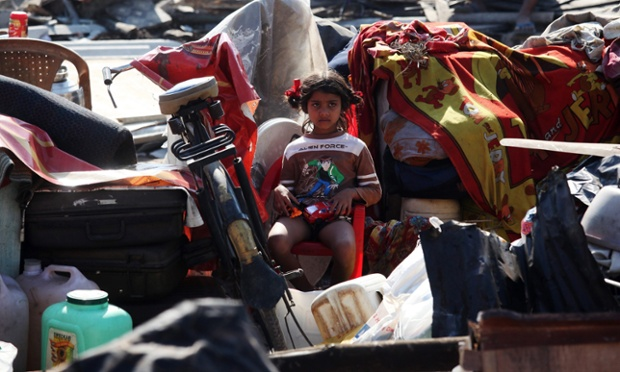 A little girl sits among her family's belongings after the demolition of illegal homes in Ganpat Patil slums in Mumbai, India. The authorities have carried out mass demolitions to remove the illegally built structures in Ganpat Patil, one of the biggest slums in the city.