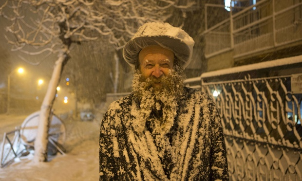Snowman: Jerusalem has been transformed overnight into a winter wonderland and forecasters are predicting snow for the UK over the weekend. Read more on the weather.