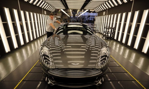 An Aston Martin Vanquish is inspected by hand inside a light booth at the company headquarters and production plant in Gaydon, England as the iconic British brand celebrates its 100th anniversary. Photograph: Christopher Furlong/Getty Images