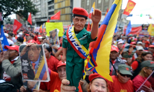 Supporters of Venezuelan President Hugo Chavez gather outside Miraflores presidential palace in Caracas. With Chavez ailing and absent, Venezuela's leftist government has launched a new presidential term with a display of popular support on the day he was to be inaugurated. The Supreme Court is allowing the cancer-stricken president, who is recovering from surgery in Havana, to indefinitely postpone his re-inauguration and said his existing administration could remain in office until he is well enough to take the oath. Photograph: Leo Ramirez/AFP/Getty Images
