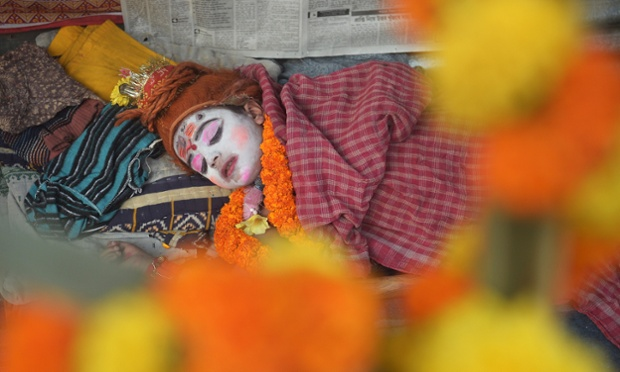 Even a little Hindu god needs a nap from time to time. Mantu Das, 6, dressed Lord Shiva is photographed at the Gangasagar temporary camp in Kolkata. Pilgrims are gathering in Kolkata on their way to the annual Hindu holy festival Gangasagar Mela, where an expected hundred thousand will take a dip in the ocean at the confluence of the River Ganges and the Bay of Bengal. The festival marks the occasion of Makar Sankranti, a holy day on the Hindu calendar considered to be of great religious significance.