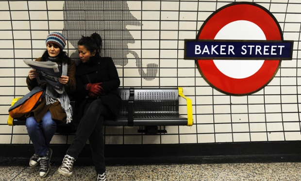 Commuters wait for an Underground train at Baker Street station, in London today. The London Underground is celebrating its 150th anniversary this year. Seen on the wall is a silhouette of British author Sir Arthur Conan Doyle's most popular character 'Sherlock Holmes', who according to his novels lived in Baker Street. Check out our gallery of historic underground pictures.