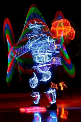 A performer puts on a dazzling light show prior to the Euroleague basketball match CSKA Moscow against Brose Baskets Bamberg in Moscow, Russia.