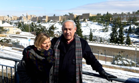 Binyamin Netanyahu and his wife Sara in a snowy Jerusalem on 10 January 2013.