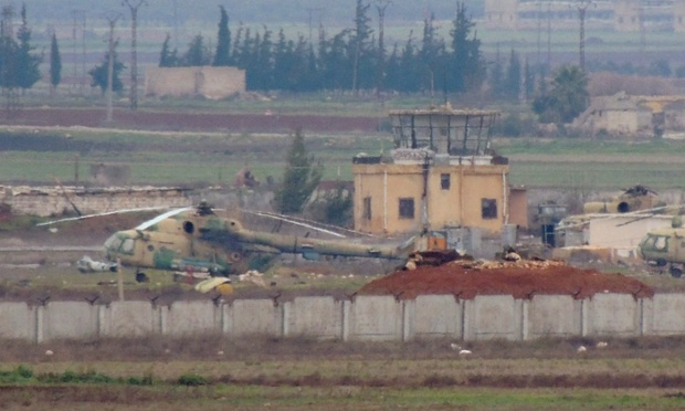 Syrian air force helicopters at the captured base in Taftanaz in the northern province of Idlib. Islamist rebels seized control of the base on Friday after storming the compound with a captured tank earlier this week.