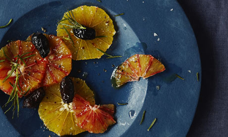 Citrus salad with fried rosemary and olives