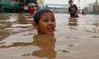 A boy in a flooded road in Jakarta