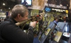 A man tries out a civilian version of the Colt M4 carbine at the Shooting, Hunting, Outdoor Trade Show in Las Vegas.