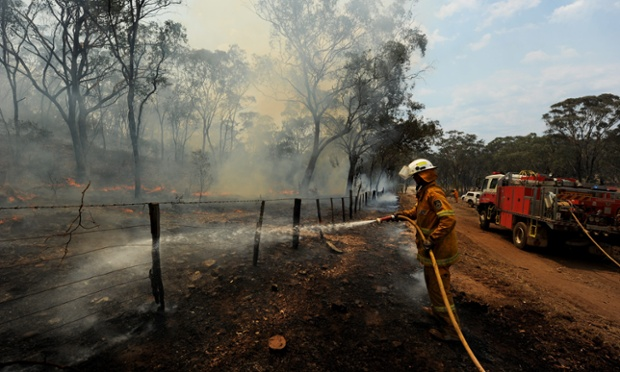 Meanwhile, rural fire service volunteers backburn to protect properties near the north-western town of Coonabarabran, Australia. A 40,000-hectare bushfire is burning in the Warrumbungle national park