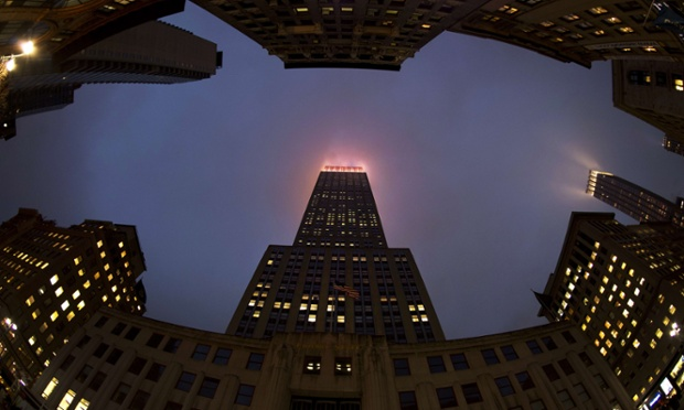 The lights of the Empire State Building illuminate the fog in New York. Recently the building's metal halide lamps and floodlights were replaced with LED fixtures, increasing the available colours from nine to more than 16 million