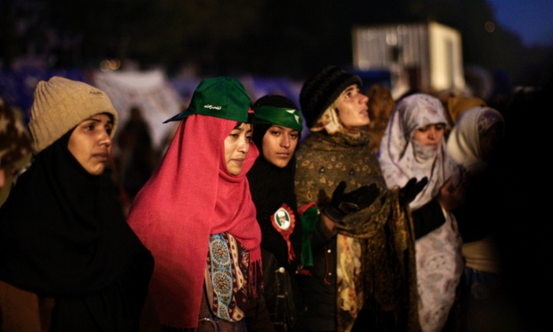 Supporters of the Pakistani Sunni Muslim cleric Tahir-ul-Qadri, chant prayers while camping out near the parliament, during an anti-government rally in Islamabad