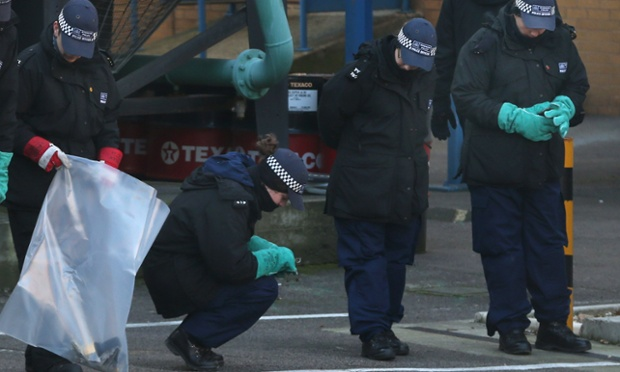 Police search an area near the scene of a helicopter crash in London. Police cordons have remained in place as investigations continue into the cause of yesterday's helicopter crash in which two people died.