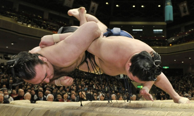 Ouch: the junior champion Goeido, right, throws the champion Kotooshu to win a bout at the New Year Grand Sumo tournament in Tokyo, Japan
