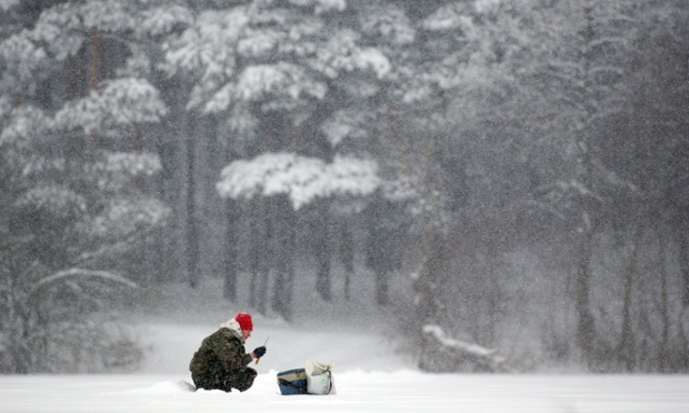 Frozen fishfingers? A fisherman sits on an icy lake on the outskirts of the Belarusian capital, Minsk