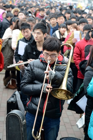 Where there's brass: student applicants wait to take admissions tests at the Artistic Vocational College of Anhui in Hefei, China
