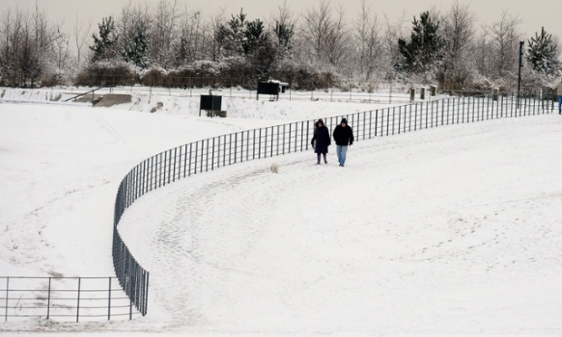 A couple walk their dog in Herrington Country park near Sunderland today as the cold snap continues to hit the UK.